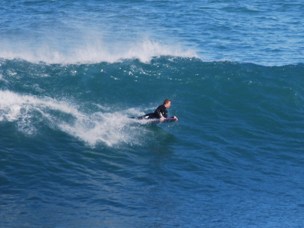 Body Boarding on a wave in Newquay